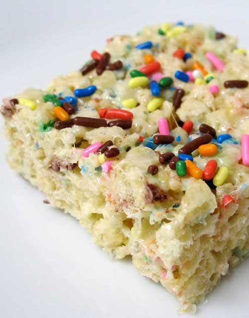 This Cake Batter Rice Krispie Treats recipe brings back a favorite sticky childhood treat, combined with the fun of licking the cake batter spoon.