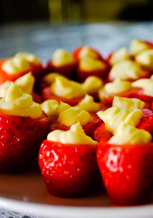 You'll love these guilt-free little cheesecake stuffed strawberries. So easy and perfect for spring or summer parties!