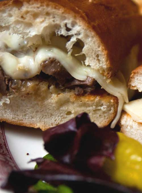 Recipe for Slow Cooker French Dip Sandwiches - Slow cooker French dip sandwiches are an easy Sunday meal. A beef roast is cooked low and slow in a rich beef stock until it becomes tender and literally falls apart. The meat is then tucked into a soft roll and served with au jus.