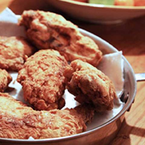 I've made fried chicken using lots of recipes. In recent years, the recipe that gets the most rave reviews is this one here. The secret is in the brine.