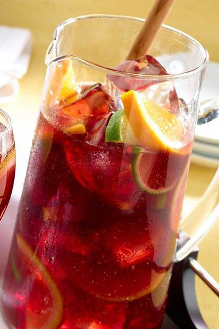 Tea is perfect for these hot summer days. Add some fruit juice to it, and it magically becomes this even more perfect Sparkling Sangria Tea! #tea #drinks #fruit #summer