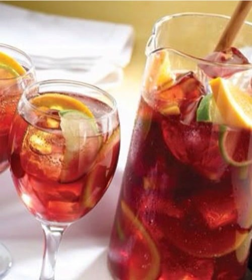 Tea is perfect for these hot summer days. Add some fruit juice to it, and it magically becomes this even more perfect Sparkling Sangria Tea!