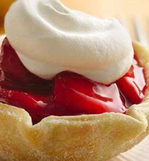 Recipe for Fresh Strawberry Tarts - It's easier than you think: The tart shells are made with an inverted muffin pan. Pie crust rounds are draped over the inverted cups and baked. Then, just fill and enjoy!