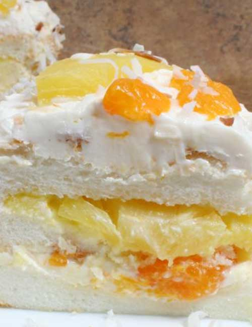 An angel food cake with lots of fresh flavor. The pineapple, mandarin oranges, and toasted coconut give this cake recipe a tropical flair.