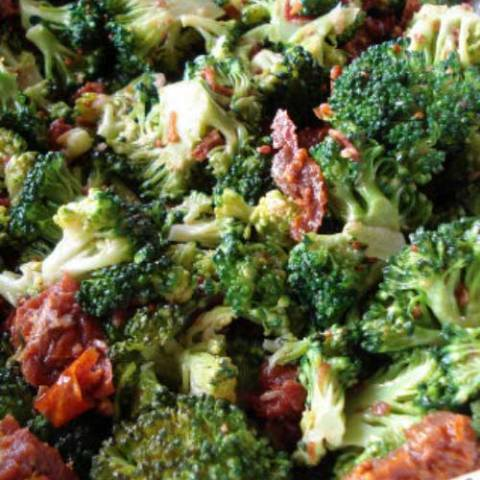 Recipe for Broccoli Salad with Crisp Bacon Bits - This is the classic broccoli salad that everyone loves. Crispy, crunchy, and loaded with bacon-y goodness!