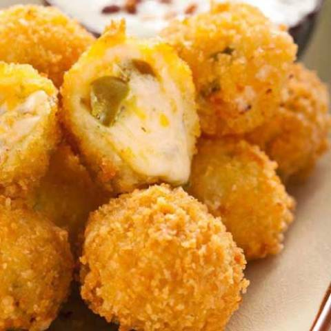 These Jalapeno Cheese Fritters are the ultimate appetizer. Gooey cheese and jalapenos in a crunchy shell. What more could you want? - A copycat recipe from Abuelo's Mexican Food Embasy.. YUM!!