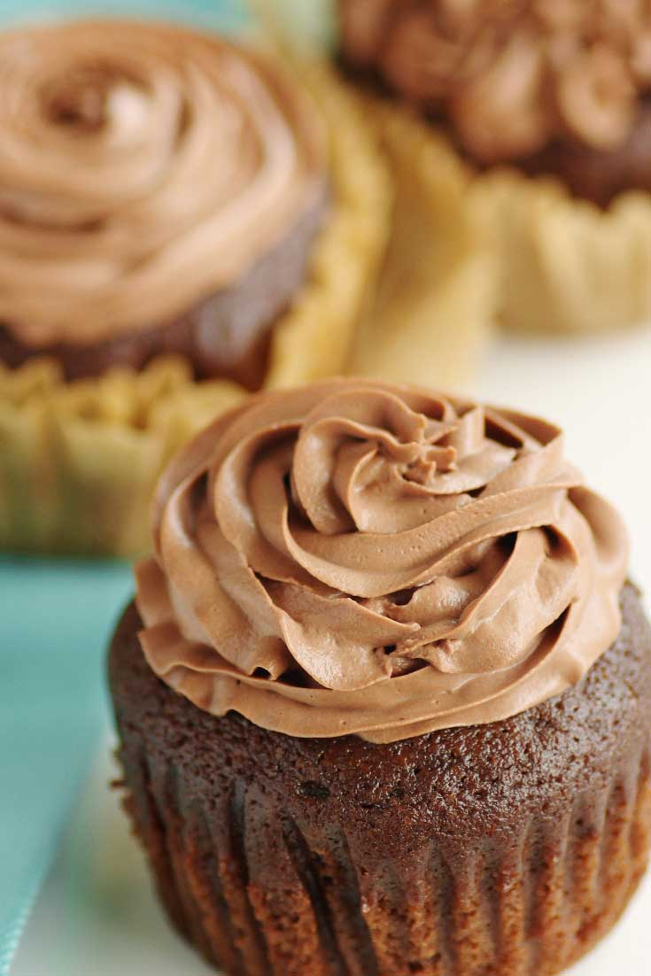 Kahlua and chocolate, two flavors that are perfect on their own. Combine the two and...good luck not eating all of these Kahlua Cupcakes with Kahlua Chocolate Mousse Frosting on your own. #chocolate #kahlua #cupcakes #dessert