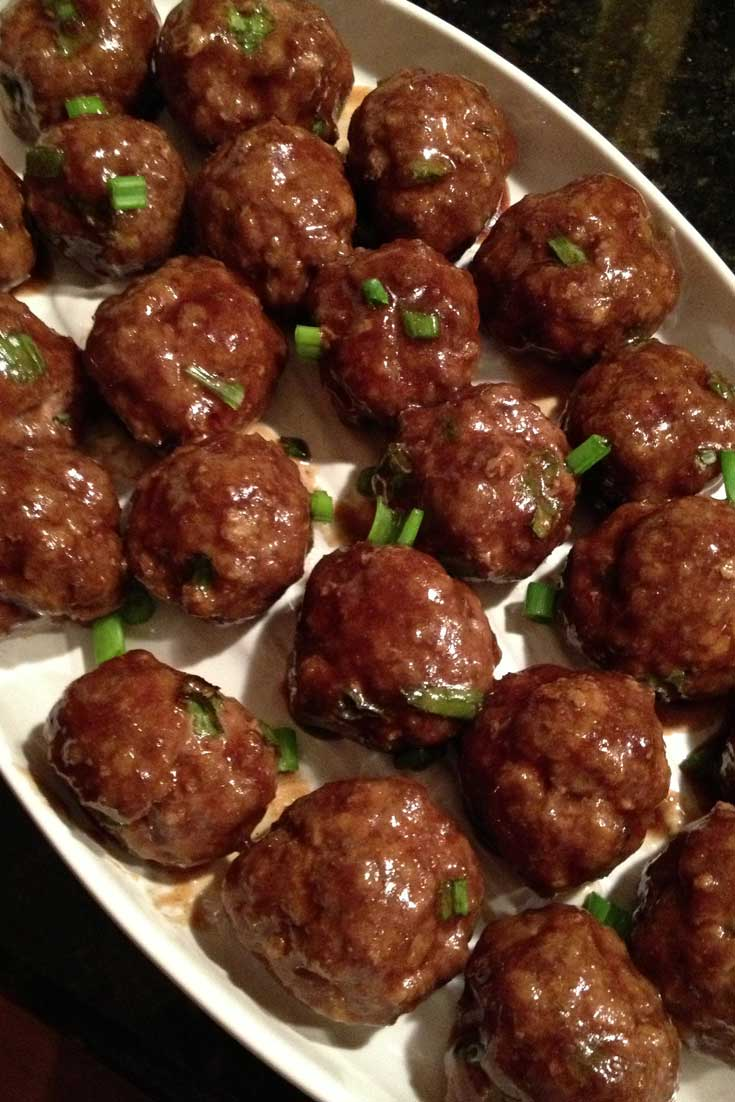 These tasty Asian Style Meatballs have a great punch of Asian flavors. Set a plate out of these easy-to-make meatballs and they'll disappear before you know it! #meatballs #partyfood #tailgating #Asian