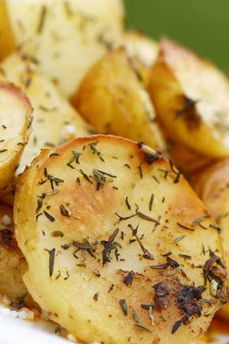 Roasted to perfection with lemon, oregano and garlic. These Garlic and Oregano Roasted Potatoes are sure to have your family asking for seconds. #potatoes #sidedish