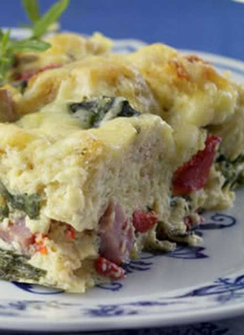 Recipe for Ham and Cheese Breakfast Casserole - This healthy update of a traditionally rich ham-and-cheese breakfast strata has plenty of flavor, with half the calories and one-third the fat of the original.