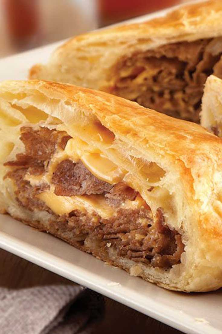 These upscale Philly Cheesesteak Rolls feature flaky puff pastry instead of ordinary rolls. They're easy to make, and even easier to enjoy! #cheesesteak #beef #cheese #puffpastry