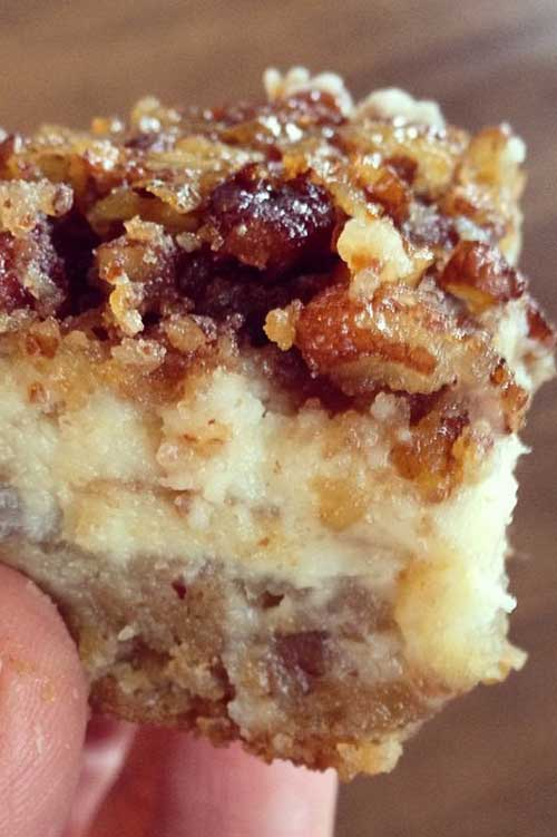 You can't go wrong with a layer of shortbread, a layer of cheesecake and a layer of pecan pie in every bite! My daughter calls these Pecan Cheesecake Squares,