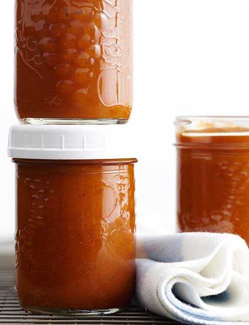 Savor pumpkin even after the season — this canning recipe combines sweet pumpkin puree and maple syrup with tangy lemon juice and ground ginger.