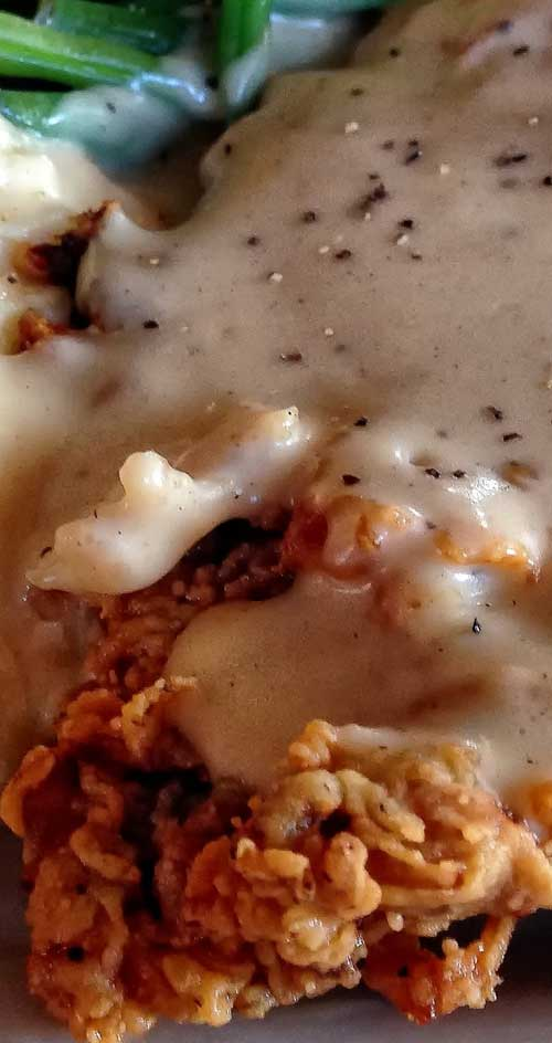 These crispy Chicken Fried Steaks smothered in gravy will earn raves when you serve them for dinner. You may almost feel guilty when you see how easy it is to make. #dinnerideas #steak #comfortfood #easyrecipe
