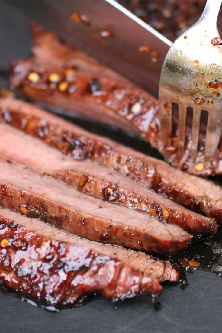 This Soy-Glazed Flank Steak turned out just great -- thin, tender slices of sweet, smoky meat-- punched up by sock-'em Asian flavors that really amp up the wow-factor. #steak #beef #dinnerideas
