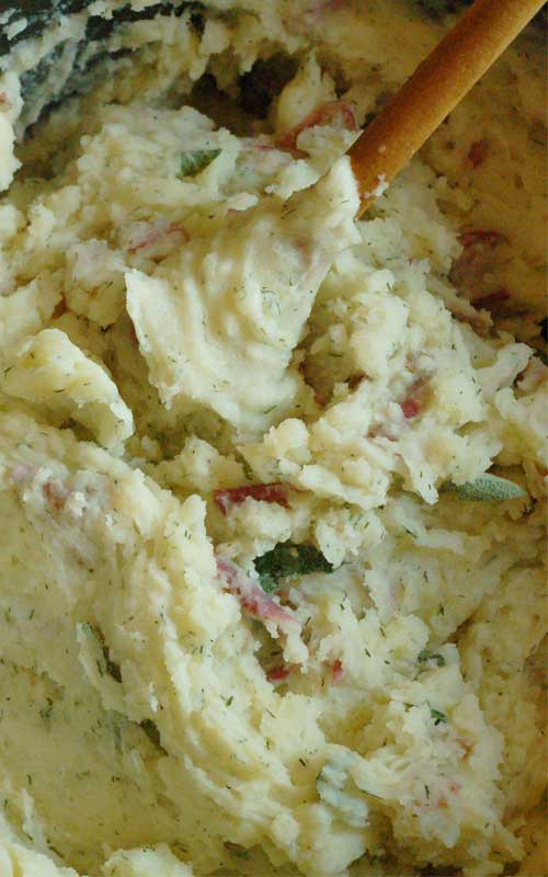 Recipe for Herb Mashed Potatoes with a Super Simple Gravy - While gravy tastes good on pretty much anything you eat at Thanksgiving, I've served it here with its classic pal, mashed potatoes.
