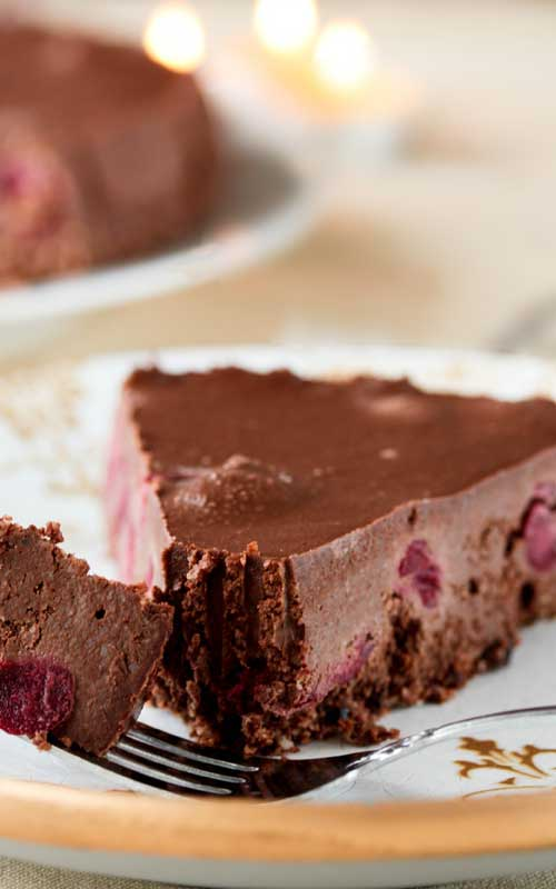 This Black Forest Chocolate Cheesecake drew quite a knockout reaction when I made it, and I'm sure you can see why. It is bursting with sweet cherries layered between a chocolate crust and a creamy chocolate cheesecake filling.