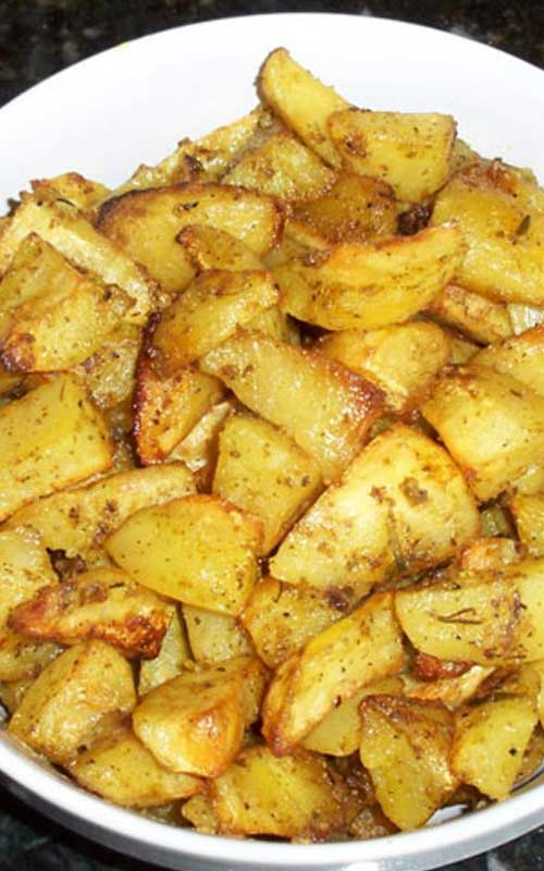 These Oven Roasted Garlic Potatoes have become a family favorite. The potatoes roast slowly in a bath of lemon and olive oil, soaking up all the garlic-y goodness!