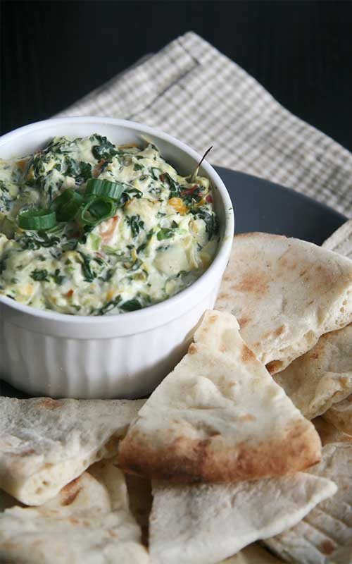 Recipe for Copycat Applebee's Spinach and Artichoke Dip - A delicious blend of mozzarella, parmesan, and romano cheeses, combined with spinach and artichoke, makes this a killer copycat recipe!