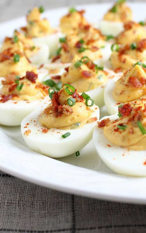 These yummy Smoky Deviled Bacon And Eggs went over so well at our summer cookouts, I started making them for holiday dinners as well. Everyone likes the addition of crumbled bacon.