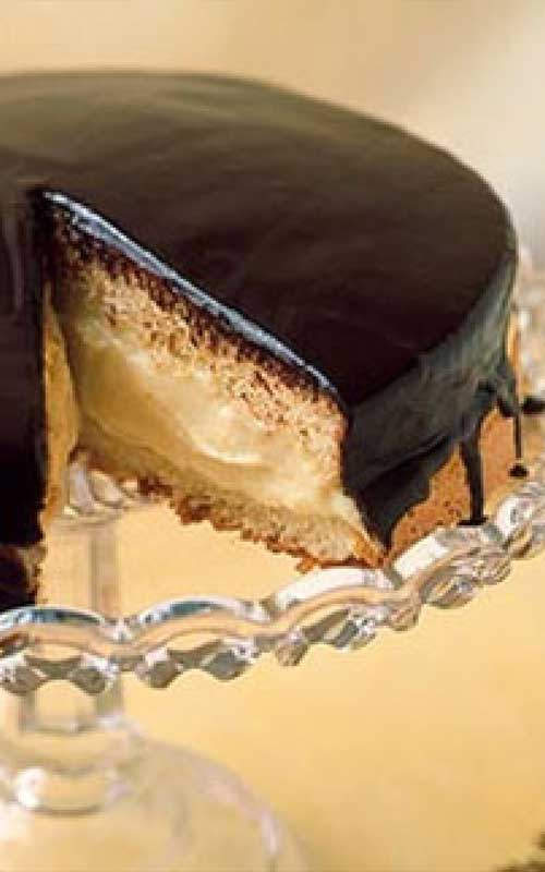 This American classic Boston Cream Pie, first made by a Boston chef in the 1850s, isn't actually a pie at all, it's a cake: two sponge layers with custard-cream filling and a shiny chocolate glaze.