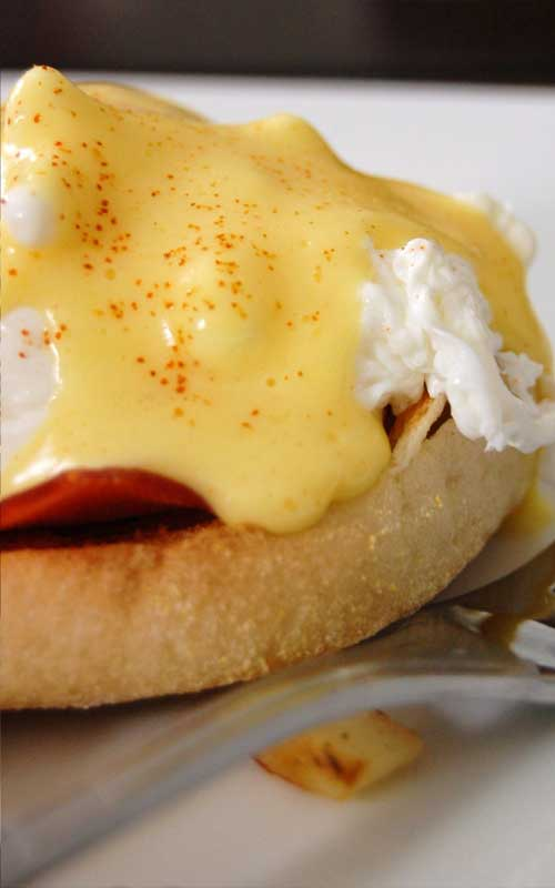 Hot buttered English muffins, Canadian-style bacon, and poached eggs are topped with a heavenly drizzle of hollandaise sauce. Breakfast does not get any better than a classic Eggs Benedict!