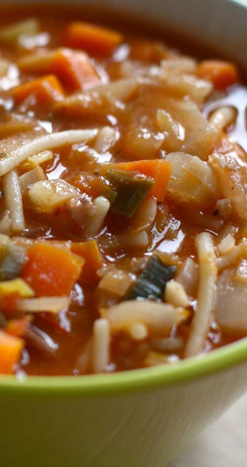 This Winter Minestrone Soup really can be made in less than an hour and tastes like it simmered all day. Minestrone lends itself to variations, so improvise with the ingredients that you have on hand. #soup #easyrecipe
