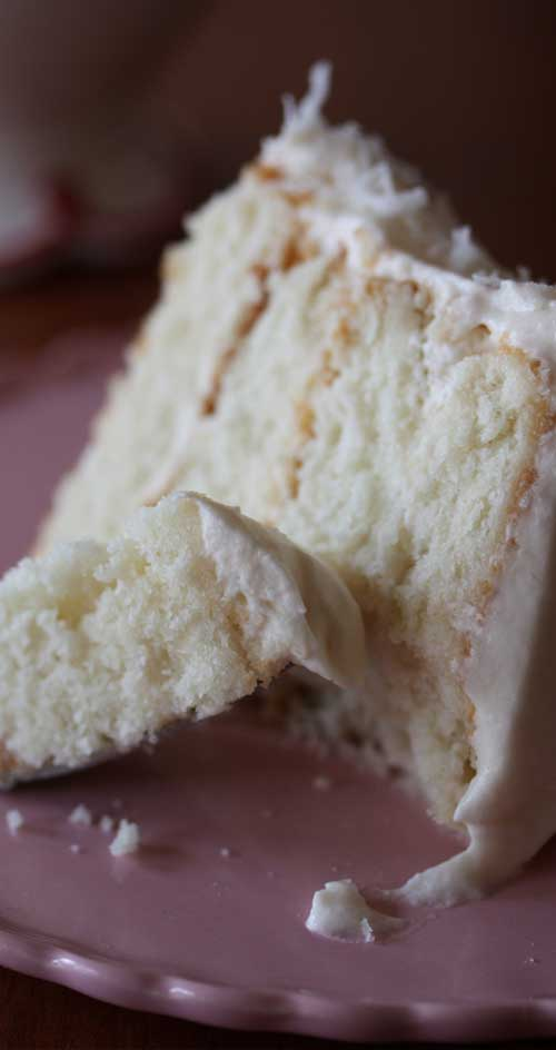 This Southern Style Coconut Cake is really beautiful, and the coconut flavor in the cake was nice and subtle. The frosting is out of this world delicious and not coyingly sweet or rich...perfect!! #cake #cocount #dessert