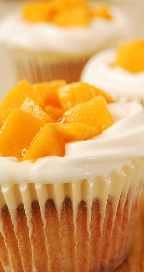 If you love cream cheese and mango together with a super light and moist, bakery-like cupcake...then this is for you! #cupcakerecipe #mangocupcakes #mangorecipe