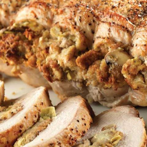 Recipe for Pork Roast with Herbed Artichoke and Mushroom Stuffing - We love this springtime artichoke and mushroom-stuffed pork roast that's not only elegant but juicy and delicious!