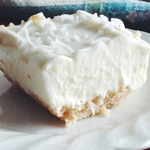 Recipe for Key Lime Bars - Classic Key lime pie taste in a bar! These easy-bake citrus bars are a refreshing treat for everyday or on any dessert buffet.