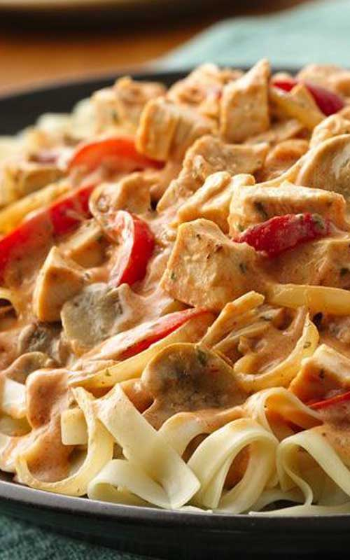 Recipe for Cajun Chicken Fettuccine - Colorful veggies and traditional Cajun seasonings combine with rotisserie chicken to quickly create this spicy chicken dinner.