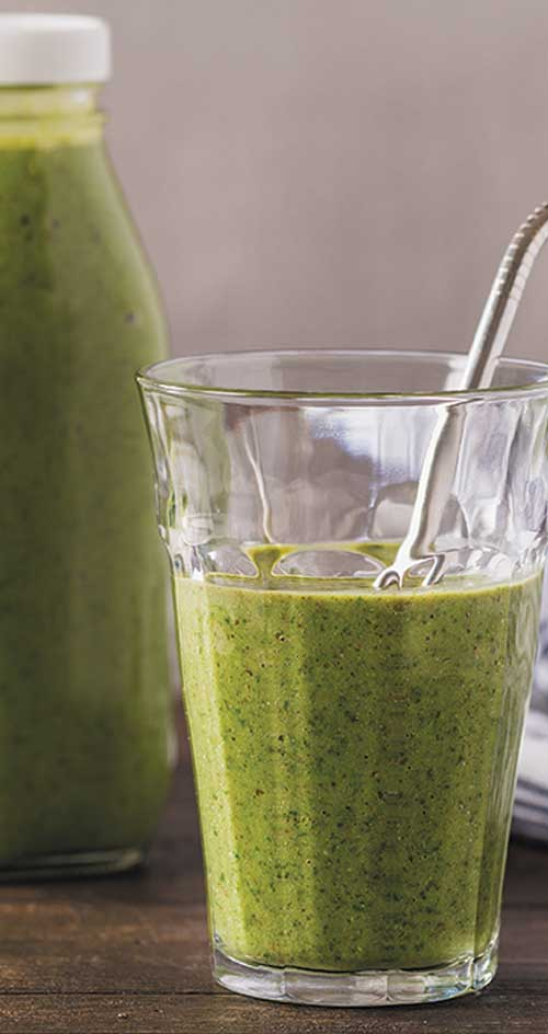 This Power Green Smoothie is chock-full of green goodness. Pineapple and pear balance the leafy greens making this a go-to smoothie at any time. #smoothies #healthyrecipe #fruitdrink
