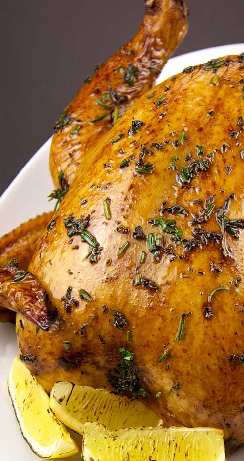 This herb roasted chicken comes out perfectly moist and tender.  Every bite is full of fresh vibrant flavors of rosemary, sage, thyme and lemon. #chickenrecipe #copycat #whatsfordinner