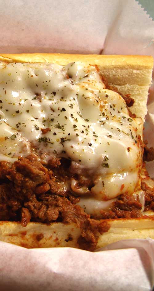 Massive, messy, AND delicious! You will love this pizza steak sub loaded with thinly sliced prime rib, sauteed onions and peppers, and covered in pasta sauce and gooey, melted mozzarella cheese.
