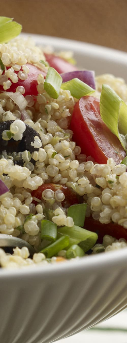 What a party of flavor! A tasty side salad featuring quinoa and a colorful variety of vegetables. Feta cheese and a light lemon dressing complete the Mediterranean Quinoa Salad. #quinoa #salad #healthy #sidedish