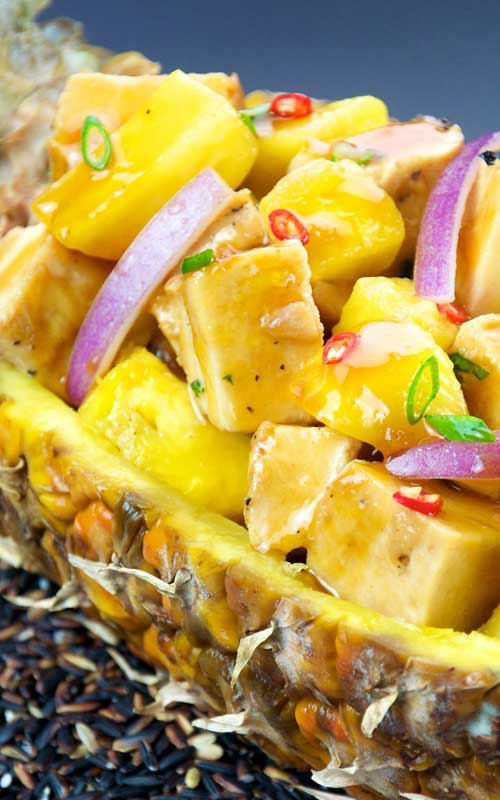 A quick and healthy chicken dish that will take your kitchen table to the islands with it's sweet and spicy flavors. Serve this spicy pineapple chicken over rice for an easy, delicious, and healthy meal!
