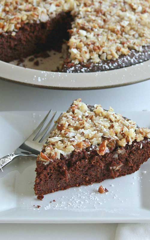 This Pecan Coconut Topped Brownie Pie is an easy to make dessert that will make any day special. A tried and true brownie recipe which has an easy pecan and coconut topping.