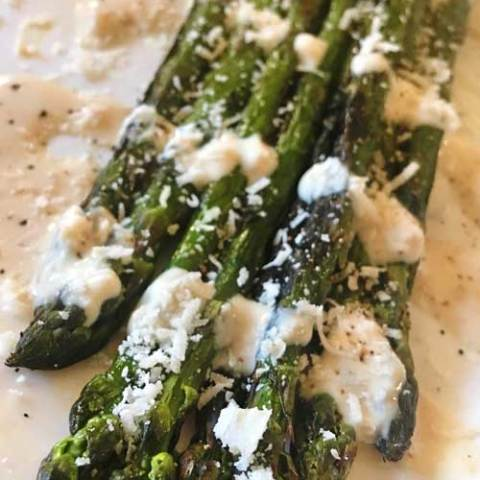 Looking to change up your boring Caesar salad? This Caesar Grilled Asparagus Salad replaces lettuce with asparagus, and could not be any more delicious!