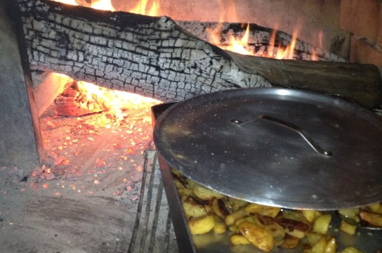 If you celebrate and cook outdoors this holiday try potatoes cooking on wood-burning stove
