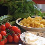 Radiatori pasta with ricotta, zucchini and tomatoes