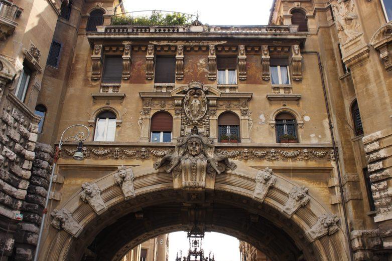 Arch entryway to the Coppedé neighborhood along Via Dora