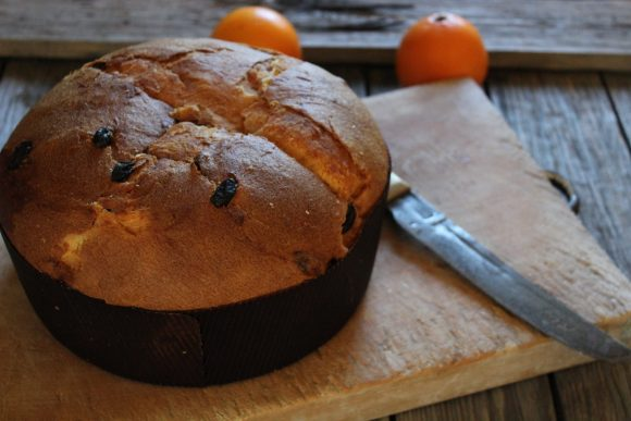 Fresh baked panettone for Christmas with orange zest and candied orange