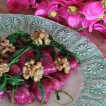 Beet and ricotta gnocchi with wilted arugula and toasted walnuts