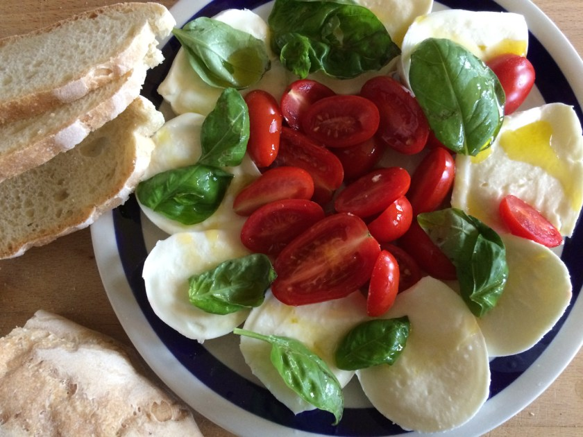 Insalata Caprese is made from alternating layers of fresh buffalo mozzarella and tomatoes, then drizzled with  extra virgin olive oil and topped with fresh basil leaves