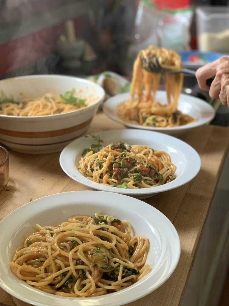 Serving 'Nduja Spaghetti with Slivered Zucchini and Arugula