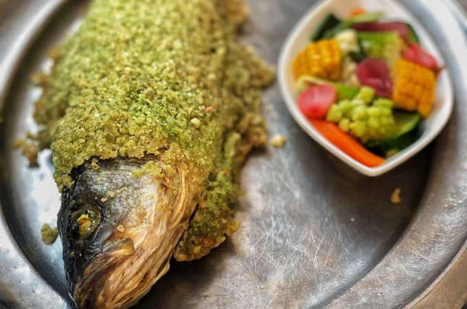 Salt crusted fish with herbs at Rome's Pierluigi restaurant