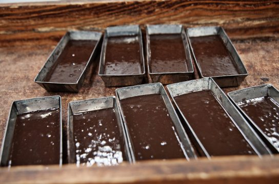 Preparing chocolate bars in Monica, Sicily