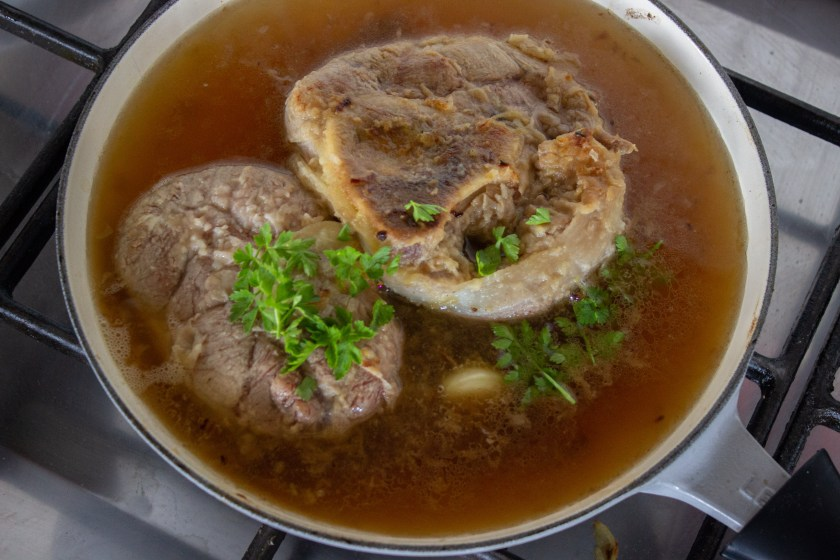 Simmer the veal shanks in beef broth