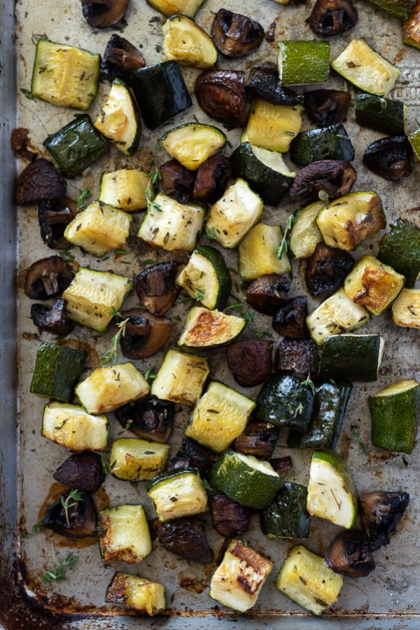 sheet pan with caramelized roasted zucchini and mushrooms